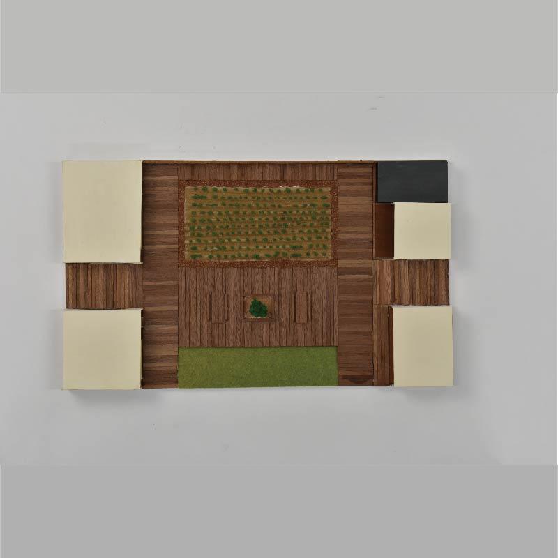 4種類の間取りを持つ住戸の中心に畑を配置し、ウッドデッキによってそれぞれの家を繋ぐ。